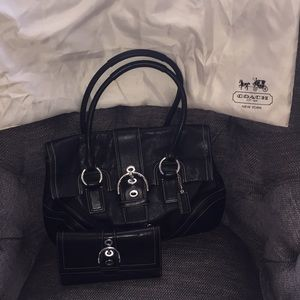 Black leather coach set with silver buckle accent